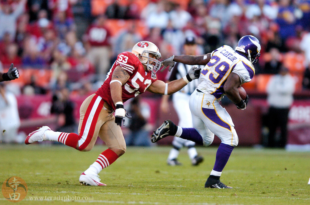 Nov 5, 2006 San Francisco, CA, USA: San Francisco 49ers linebacker Jeff Ulbrich (53) defends against Minnesota Vikings running back Chester Taylor (29) during the second half at Monster Park. The 49ers defeated the Vikings 9-3.