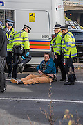 The police arrest teh last protestor who blocked the slip road to the M4 - Protestors block roads on the routes into Heathrow from the M4. Several are arrested.