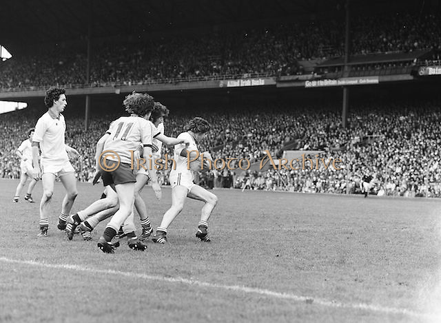 Dublin tries to hold onto the ball as he is surrounded by Kerry players during the the Kerry v Dublin All Ireland Senior Gaelic Football Final in Croke Park on the 24th of September 1978. Kerry 5-11 Dublin 0-9.