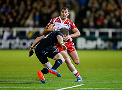 Gloucester Inside Centre Mark Atkinson is challenged by Newcastle Full Back Alex Tait - Photo mandatory by-line: Rogan Thomson/JMP - 07966 386802 - 21/11/2014 - SPORT - RUGBY UNION - Newcastle upon Tyne, England - Kingston Park - Newcastle Falcons v Gloucester Rugby - Aviva Premiership.