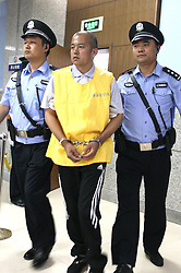 60087528  <br /> Wang Shujin, a man who has confessed to crimes for which another man has already been executed, is escorted to the Handan Intermediate People's Court in Handan City, north China's Hebei Province, July 10, 2013. The trial of Wang re-opened here on Wednesday. Nie Shubin was executed in 1995 at the age of 21 for the 1994 rape and murder of a woman in the provincial capital of Shijiazhuang. After Wang was apprehended by police in 2005 for three separate rape and murder cases, he confessed to also having raped and murdered the woman in Shijiazhuang. China, July 10, 2013.<br /> Photo by imago / i-Images