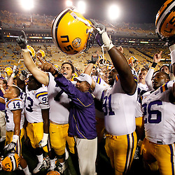 Sep 18, 2010; Baton Rouge, LA, USA; LSU Tigers head coach Les Miles gathers with players to sing the Tigers fight song following a win over the Mississippi State Bulldogs at Tiger Stadium. The LSU Tigers defeated the Mississippi State Bulldogs 29-7. Mandatory Credit: Derick E. Hingle