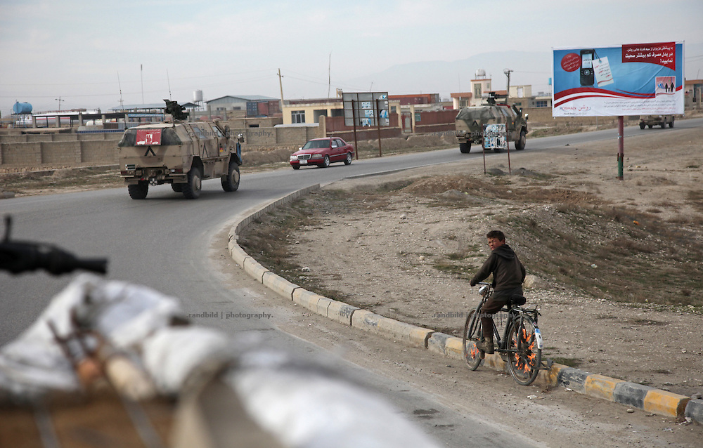 An armored convoy of the german Quick Reaction Force (QRF) patrols in the surroundings and centre of northern afghani town Mazar-e Sharif.