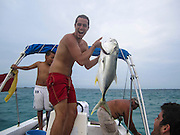 Caye Caulker, Belize. European tourist fishing