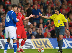 CARDIFF, WALES - Friday, September 5, 2008: Wales' Gareth Bale is booked by referee Aleksandr Stavrev during the opening 2010 FIFA World Cup South Africa Qualifying Group 4 match at the Millennium Stadium. (Photo by David Rawcliffe/Propaganda)