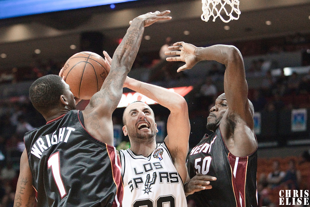 16 March 2010: San Antonio Spurs guard Manu Ginobili goes to the basket between Miami Heat forward Dorell Wright and Miami Heat center Joel Anthony during the San Antonio Spurs 88-76 victory over the Miami Heat at the AmericanAirlines  Arena, in Miami, Florida, USA.