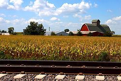 27 August 2011: High Dynamic Range image (HDR) of A farm sits just past the railroad tracks that parallel historic Route 66 near Shirley Illinois.