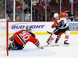 Oct 24, 2008; Newark, NJ, USA; New Jersey Devils goalie Martin Brodeur (30) tries to poke check Philadelphia Flyers right wing Mike Knuble (22) during the first period at the Prudential Center.