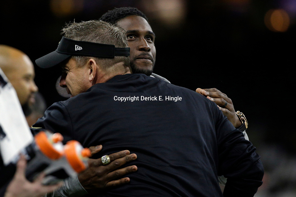 Jan 7, 2018; New Orleans, LA, USA; New Orleans Saints former running back Reggie Bush (facing camera) is hugged by New Orleans Saints head coach Sean Payton before the NFC Wild Card playoff football game against the Carolina Panthers at Mercedes-Benz Superdome. Mandatory Credit: Derick E. Hingle-USA TODAY Sports