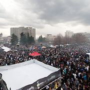 A panoramic wideangle view as smoke rises at 4:20 while thousands of participants smoke marijuana at the Civic Center Park rally. The ampitheatre, left, was later the site of a shooting.