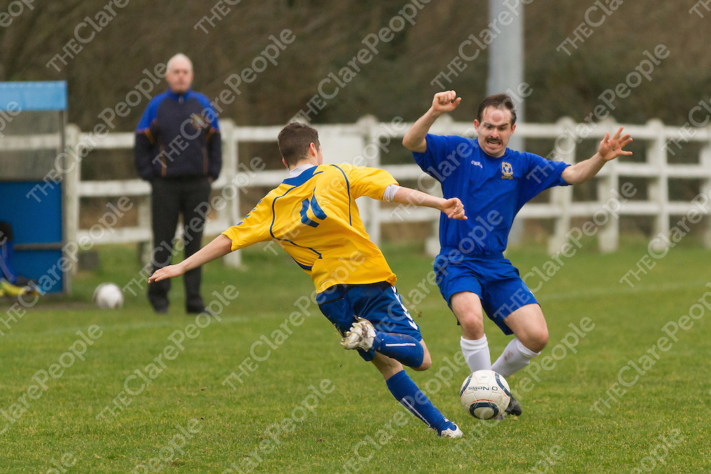 Clare's Daryl Eade blocks a kick from Roscommon's Danny Browne
