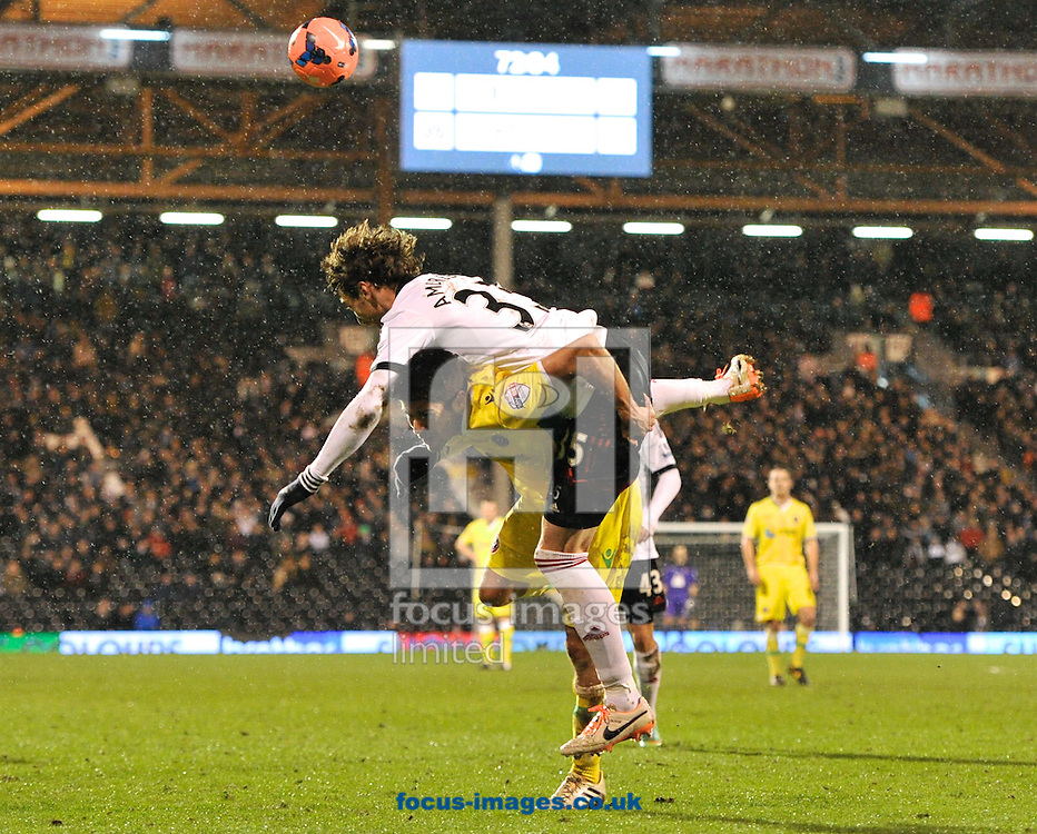 Picture by Alan Stanford/Focus Images Ltd +44 7915 056117<br /> 04/02/2014<br /> Fernando Amorebieta of Fulham and Jamie Murphy of Sheffield United during the The FA Cup match at Craven Cottage, London
