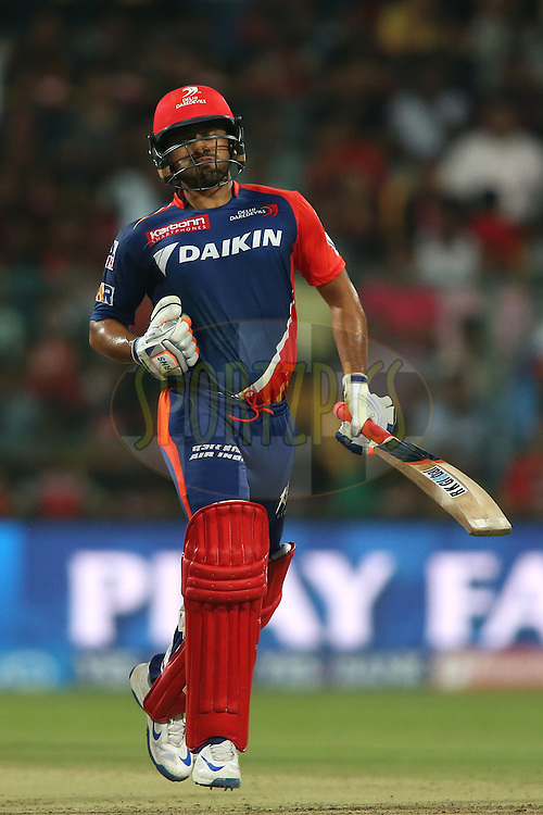 Karun Nair of Delhi Daredevils celebrates reaching his fifty during match 11 of the Vivo IPL (Indian Premier League) 2016 between the Royal Challengers Bangalore and the Delhi Daredevils held at The M. Chinnaswamy Stadium in Bangalore, India,  on the 17th April 2016<br /> <br /> Photo by Shaun Roy / IPL/ SPORTZPICS