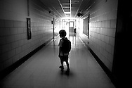 William goes to his classroom at school.
