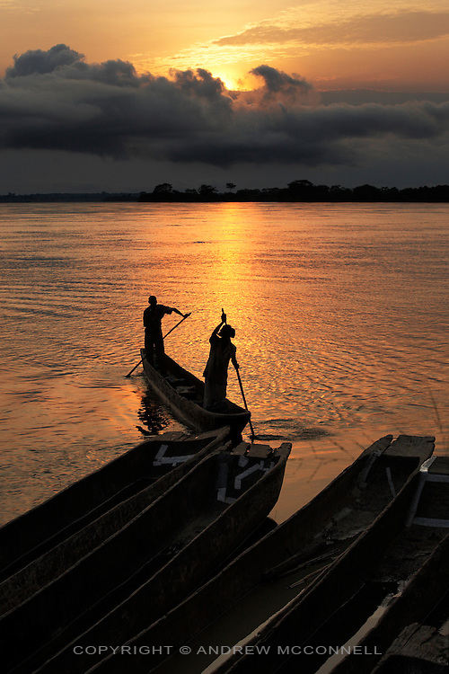 Pirogues on the Congo river at dusk, Yangambi, DR Congo, on Monday, Dec. 8, 2008. With few paved roads connecting such a vast land the Congo River serves as the country's main artery, with many towns and villages dotted along its banks and that of its tributaries.