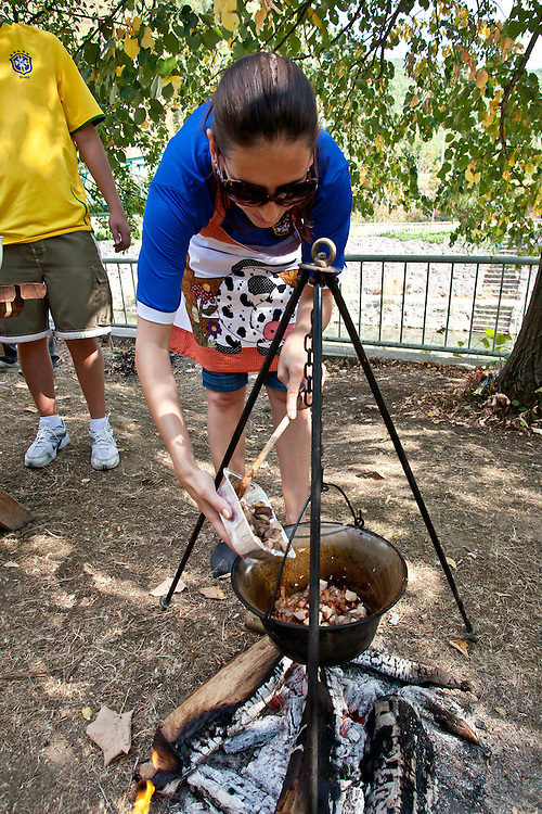 Brazilian cook Betina Peixoto Mello adds testicles to her dish at the 2011 World Testicle Cooking Championship, Ovcar Banja, Serbia.
