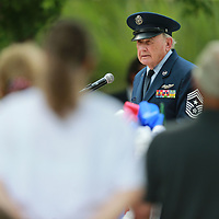 Retired U.S. Air Force Chief Master Sgt. Mark Cayson delivers Monday's invocation at the annual Memorial Day service at Veteran Park.
