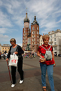 Women walk from St. Mary's Basilica through the main square in Krakow, Poland . The city, once the royal capital of Poland, will host the international World Youth Day in July 2016. (Nancy Wiechec)