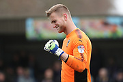 AFC Wimbledon goalkeeper George Long (1) celebrating after win during the EFL Sky Bet League 1 match between AFC Wimbledon and Oxford United at the Cherry Red Records Stadium, Kingston, England on 10 March 2018. Picture by Matthew Redman.