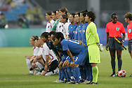 21 August 2008: The starters for Japan (in blue) and Germany (behind) pose for team photos before the game. Germany's Women's National Team defeated Japan's Women's National Team 2-0 at the Worker's Stadium in Beijing, China in the Bronze Medal match in the Women's Olympic Football tournament.