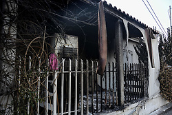 July 26, 2018 - Athens, Greece - A burned house seen in the area of the wildfire..The aftermath of the destruction by the forest fires in Mati and Neos Voutsas regions of Attiki with more than 80 dead and an unimaginable destruction of property. (Credit Image: © Giorgos Zachos/SOPA Images via ZUMA Wire)