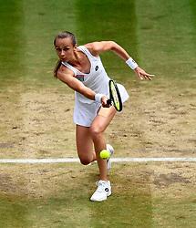 Magdalena Rybarikova in action against Garbine Muguruza on day ten of the Wimbledon Championships at The All England Lawn Tennis and Croquet Club, Wimbledon.