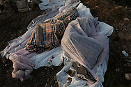 ITALY, Lampedusa :Tunisian migrants sleep on ground in Lampedusa on March 28, 2011. Copyright Christian Minelli.