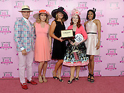 Jennifer Judkins, center, of Longines, along with Longines Ambassador of Elegance and World Cup Alpine skier Mikaela Shiffrin, second left, and celebrity judges Monte Durham, left, and Alicia Quarles, right, present Jody DeFord, of Indianapolis, with a Longines Conquest Classic after she won the Longines Kentucky Oaks Fashion Contest on Kentucky Oaks Day, Friday, May 1, 2015, in Louisville, Ky.  Longines, the Swiss watch manufacturer known for its luxury timepieces, is the Official Watch and Timekeeper of the 141st annual Kentucky Derby. (Photo by Diane Bondareff/Invision for Longines/AP Images)