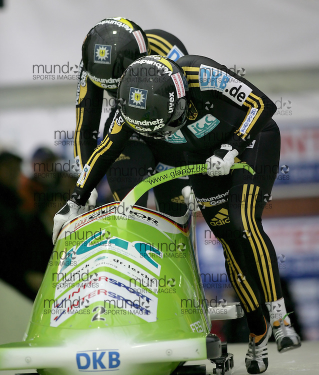 (November 21, 2009) Cathleen Martini (front) and Romy Logsch of Germany push in the first run en route to a 1st place finish at  the Federation Internationale de Bobsleigh et de Togogganing (FIBT) two-man men's bobsled World Cup race at the Olympic Sports Complex in Lake Placid, New York.