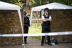 © Licensed to London News Pictures. 12/07/2020. London, UK. Police guard an entrance to a Childs play area at the Black Prince Estate in Kennington South London, just a few hundred years from the House of Parliament,  in which a man, believed to be in his 30s, was stabbed to death late last night . Photo credit: Ben Cawthra/LNP