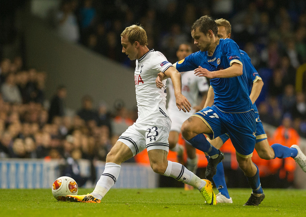 Tottenham Hotspur's Christian Eriksen fights for the ball with Tromsø Idrettslag's Remi Johansen reacts during their UEFA Europa League group match at White Hart Lane in London, 27 August 2013.  BOGDAN MARAN / BPA