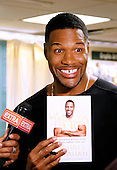 "Michael Strahan Signs ""Wake Up Happy"""