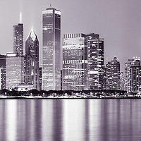 Photo of downtown Chicago city skyline at night with the Lake Michigan Lakeftont, John Hancock Building, and other popular Chicago office buildings and skyscrapers.