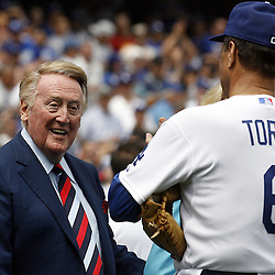 Vin Scully smiles at Joe Torre before the home opener between the San Francisco Giants and the Los Angeles Dodgers at Dodger Stadium on Monday April 13, 2009 in Los Angeles. (SGVN/Staff Photo by Keith Birmingham/SPORTS)