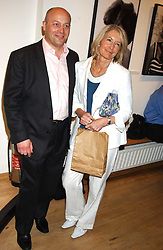 SHOLTO DOUGLAS-HOME and his mother SANDRA HOWARD at an exhibition of photographs by Robin Douglas-Home entitled 'The Sixties Set' held at The Air Gallery, 32 Dover Street, London W1 on 28th June 2005.<br />