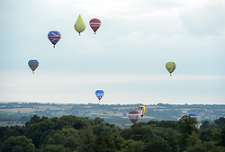 © Licensed to London News Pictures.  13/08/2017; Bristol, UK. Bristol International Balloon Fiesta 2017. The final mass ascent takes place on Sunday evening and balloons flew close to the Clifton Suspension Bridge watched by crowds. Picture credit : Simon Chapman/LNP