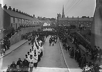 A religious parade on a street, no other information <br /> (Part of the Independent Newspapers Ireland/NLI Collection)