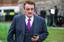 London, UK. 8 May, 2019. Tommy Sheppard MP, SNP Spokesperson on the Cabinet Office, Scotland Office, and House of Lords, walks across College Green in Westminster following an interview.