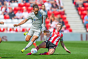 Grant Leadbitter (#23) of Sunderland AFC tackles Marcus Harness (#19) of Portsmouth FC during the EFL Sky Bet League 1 match between Sunderland and Portsmouth at the Stadium Of Light, Sunderland, England on 17 August 2019.