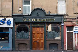 Exterior view of famous old pub MJ Heraghty on Pollokshaws Road in Glasgow, Scotland, United Kingdom