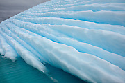 The face of an iceberg from the side with lines running horizontally along the front in Antarctica, January 2009