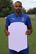 AFC Wimbledon midfielder Liam Trotter (14) holding Fifa sign during the AFC Wimbledon 2018/19 official photocall at the Kings Sports Ground, New Malden, United Kingdom on 31 July 2018. Picture by Matthew Redman.
