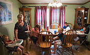 Vicki Dever feeds her grandchildren lunch in her Shepherdsville home on Wednesday, June 27. Dever and her husband have permanent custody of six grandchildren. They hope to recieve financial assistance through the reinstatement of Kinship Care, which provides relatives $300 a month per child to care for children removed from homes because of abuse or neglect.