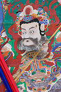 Haeinsa buddhist temple. The annual Tripitaka Koreana Festival honours the temple's collection of 81,340 carved wooden printing blocks with the complete buddhist teachings, declared a world cultural heritage in 1995. In the morning of the second day, a huge buddhist Tangka (a silk painting scroll) is suspended at the main temple yard - here a detail from it.