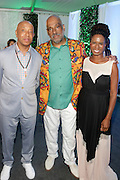 Water Mill, New York: (L-R) Music Mogul Russell Simmons, Visual Artist Danny Simmons and Tangie Murray, Executive Director, RUSH Philanthropic Arts Foundation attend the RUSH Philanthropic Arts Foundation 15th Annual Art For Life Benefit Gala held in the Hamptons at the Farmview Farms on July 26, 2014  in Water Mill, New York. (Terrence Jennings)
