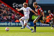 Liverpool midfielder (24) Joe Allen beats Bournemouth FC midfielder (4) Dan Gosling to the ball during the Barclays Premier League match between Bournemouth and Liverpool at the Goldsands Stadium, Bournemouth, England on 17 April 2016. Photo by Mark Davies.