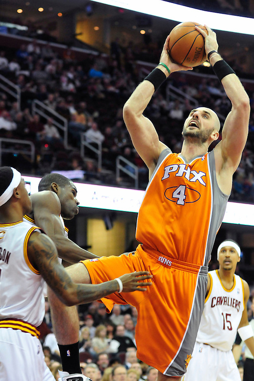 Jan. 19, 2011; Cleveland, OH, USA; Phoenix Suns center Marcin Gortat (4) shoots over Cleveland Cavaliers point guard Daniel Gibson (1) during the first quarter at Quicken Loans Arena. Mandatory Credit: Jason Miller-US PRESSWIRE