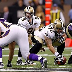 September 9, 2010; New Orleans, LA, USA;  New Orleans Saints quarterback Drew Brees (9) under center during the NFL Kickoff season opener at the Louisiana Superdome. The New Orleans Saints defeated the Minnesota Vikings 14-9.  Mandatory Credit: Derick E. Hingle