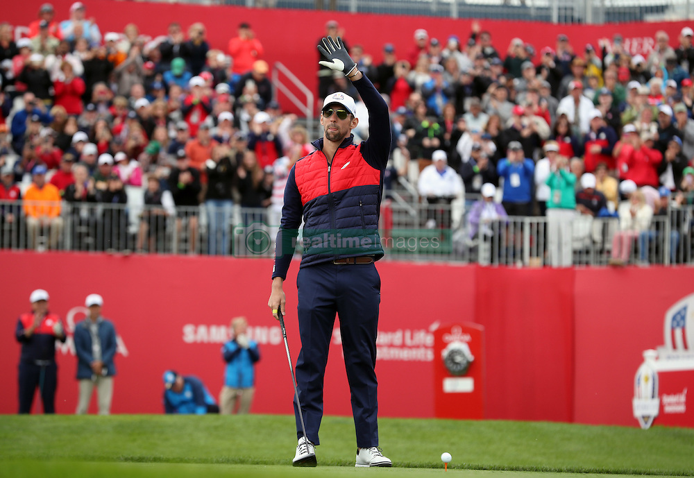 USA's Michael Phelps acknowledges the crowd during a celebrity golf match ahead of the 41st Ryder Cup at Hazeltine National Golf Club in Chaska, Minnesota, USA.
