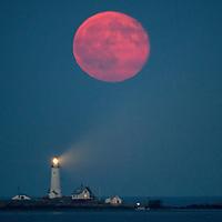 July 20, 2016-Boston,MA Tonight's full moon rises over Boston Light.